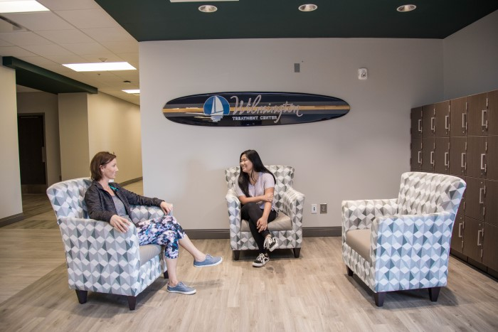 Two people sitting in a waiting area at Wilmington Treatment Center